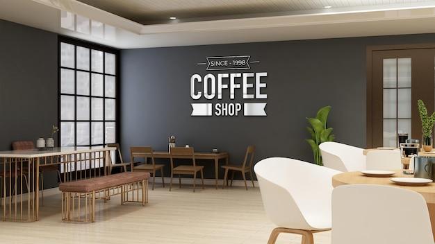 Maquette de logo de café ou de restaurant dans le café avec table et bureau