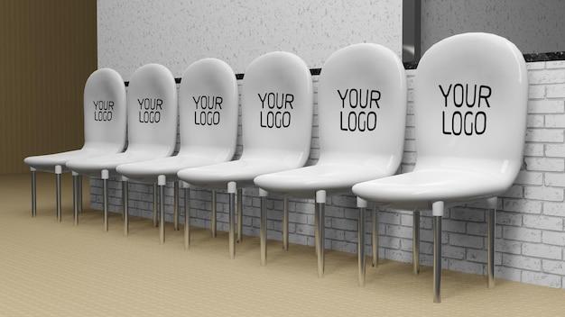 Maquette de logo sur des chaises