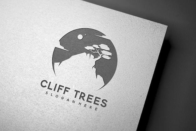 Maquette de logo en creux sur la texture du papier blanc