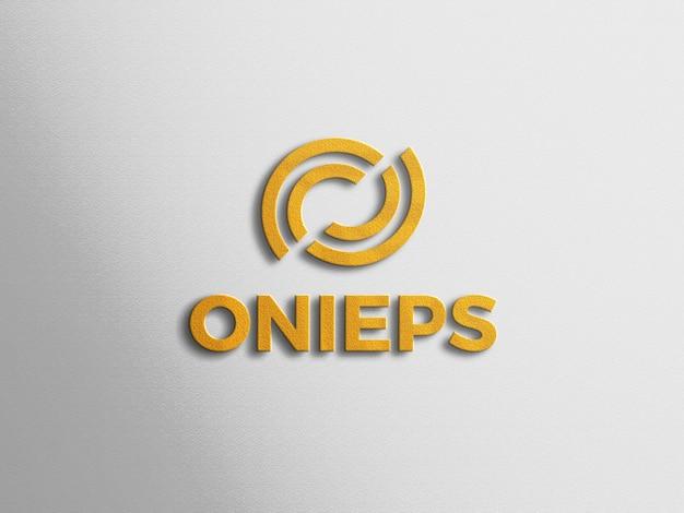 Maquette de logo doré 3d avec du papier blanc
