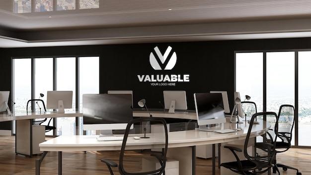 Maquette de logo d'entreprise 3d dans l'espace de travail du bureau
