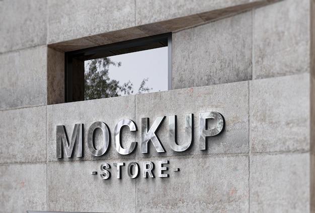 Maquette de logo d'entreprise sur façade en béton
