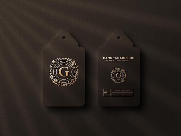 Maquette de logo d'étiquette volante de luxe avec effet doré