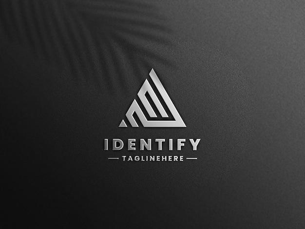 Maquette de logo de feuille d'argent de luxe sur papier noir