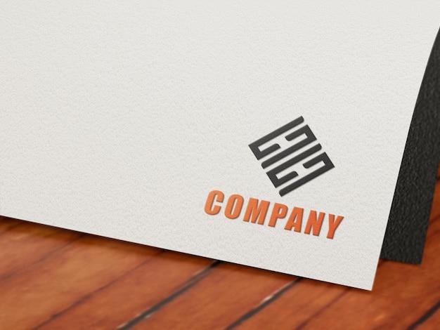 Maquette de logo en gaufrage en livre blanc