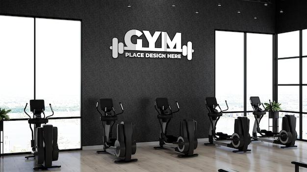 Maquette de logo de gym réaliste dans la zone de remise en forme pour l'exercice des athlètes