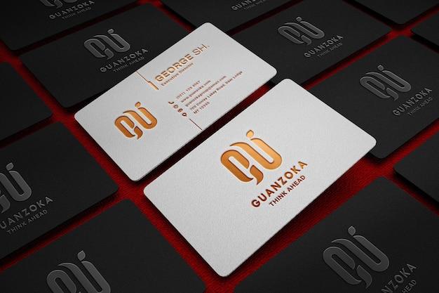 Maquette de logo de luxe sur carte de visite blanche et noire