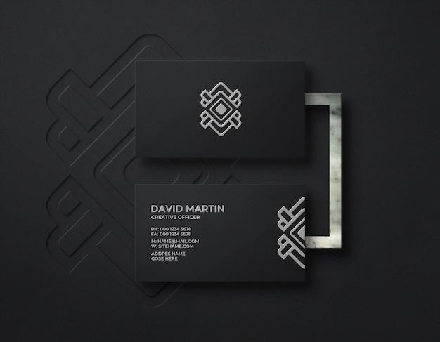 Maquette de logo de luxe sur carte de visite noire avec effet en relief et typographie
