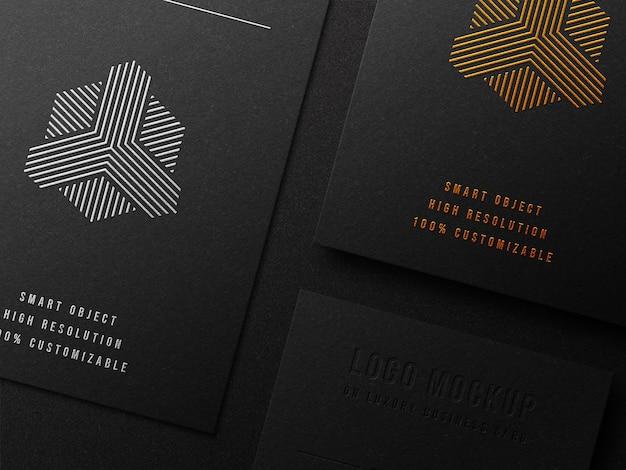Maquette de logo de luxe sur carte de visite avec typographie et effet de relief