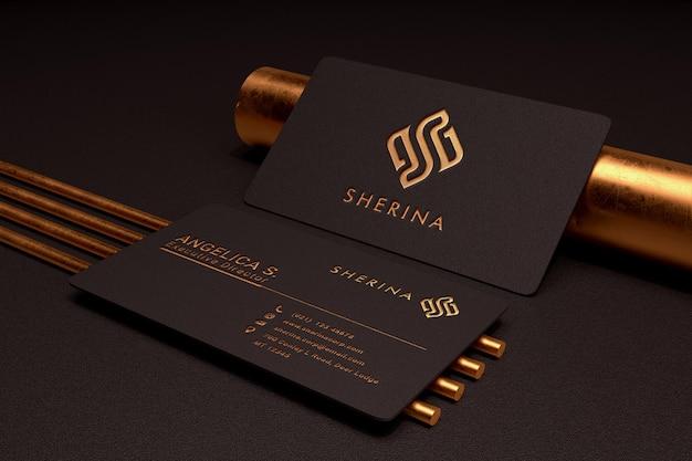 Maquette de logo de luxe et minimaliste sur une carte de visite sombre