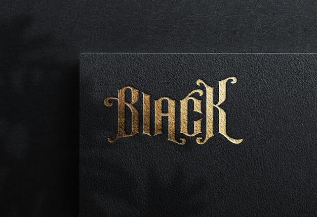 Maquette de logo de luxe sur papier kraft noir