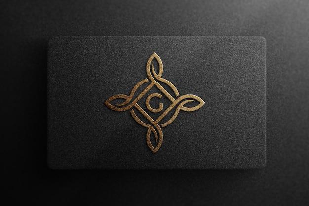 Maquette de logo de luxe sur papier noir