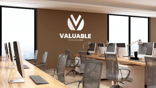 Maquette de logo mural 3d dans un espace de travail de bureau moderne avec mur marron