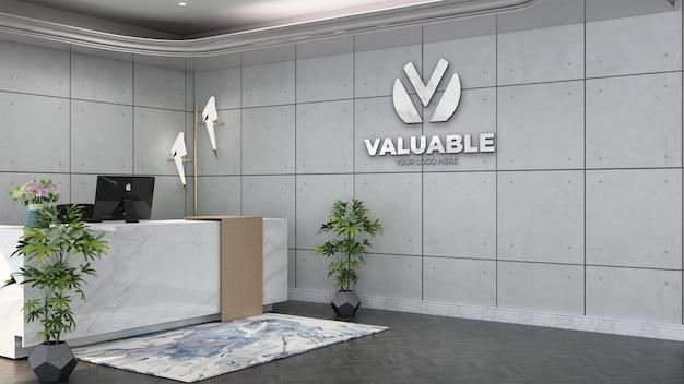 Maquette de logo mural dans la réceptionniste du bureau ou à la réception avec un intérieur de design industriel blanc