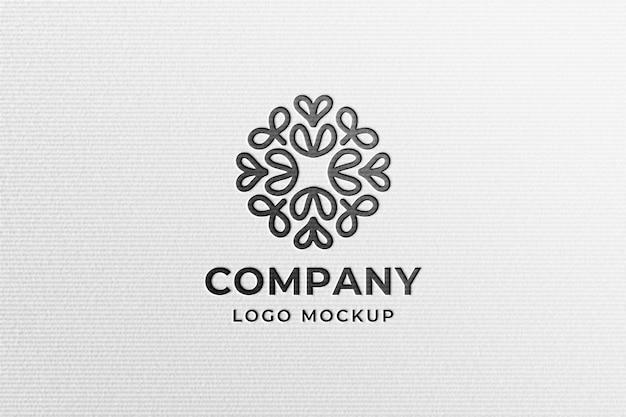 Maquette de logo noir moderne simple en papier pressé blanc