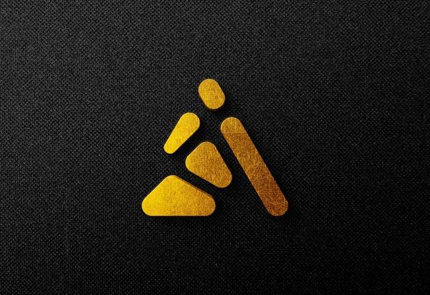 Maquette de logo en or 3d sur un mur sombre