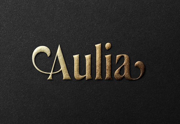 Maquette de logo d'or de luxe sur papier noir