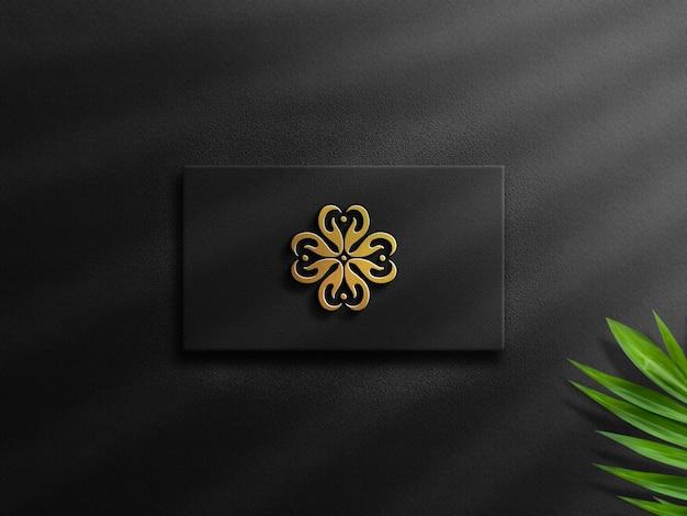 Maquette de logo en or en relief de luxe 3d sur carte de visite