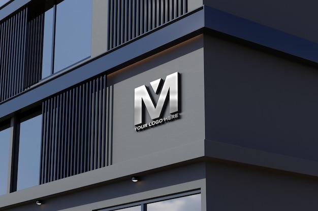 Maquette de logo sur panneau de bâtiment de bureau de magasin de façade noire