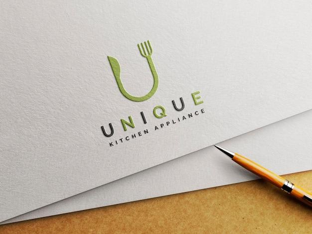 Maquette De Logo En Papier Gaufré Avec Stylo PSD Premium