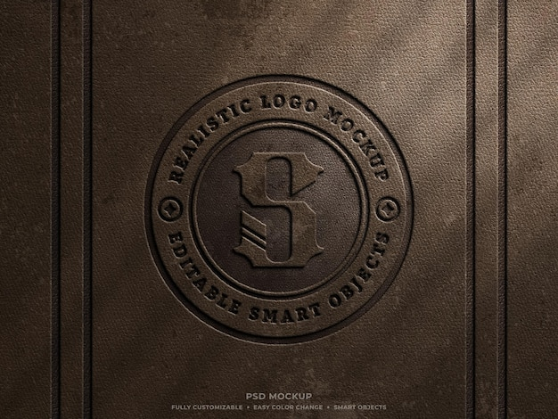 Maquette de logo pressé en cuir grungy rustique sur une maquette de logo gravé vintage en cuir marron ancien