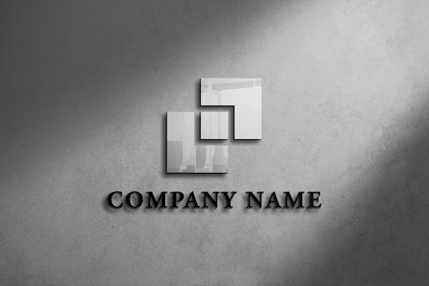 Maquette de logo réaliste sur le mur avec un design de fond gris
