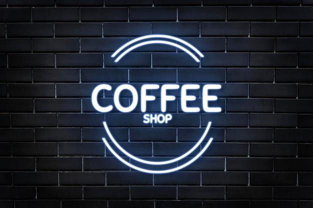 Maquette de logo en relief néon psd pour café sur fond de mur de briques sombres
