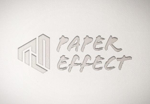 Maquette de logo en relief sur la texture du papier blanc
