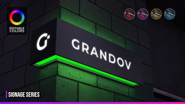 Maquette de logo de signalisation sur façade d'angle ou devanture de magasin avec éclairage de nuit
