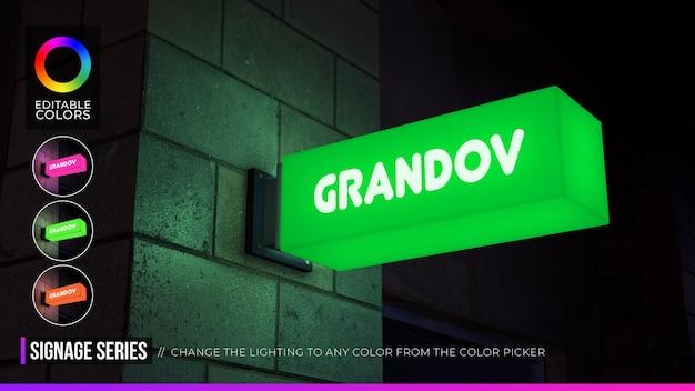 Maquette de logo de signalisation rectangulaire sur façade ou devanture de magasin avec éclairage de nuit