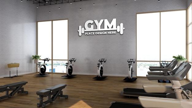 Maquette de logo de sport dans la salle de fitness avec mur blanc