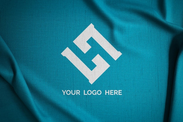 Maquette de logo sur tissu vert
