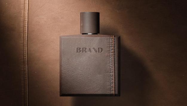 Maquette de logo typographique sur bouteille de parfum en cuir