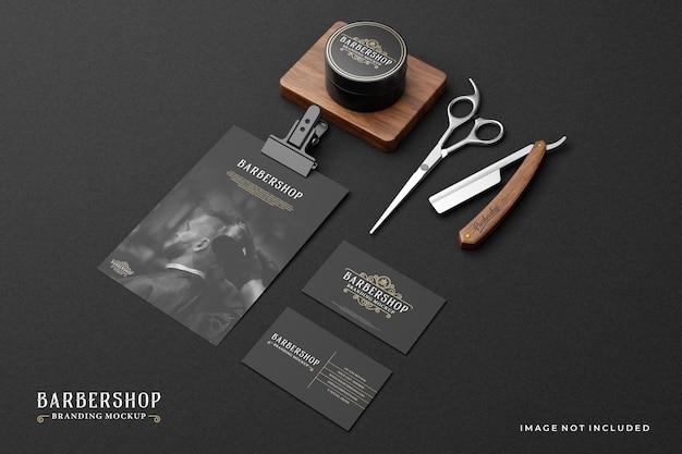 Maquette de marque de salon de coiffure dans un thème sombre