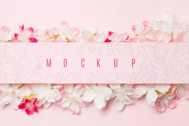Maquette de message entourée de fleurs de jasmin