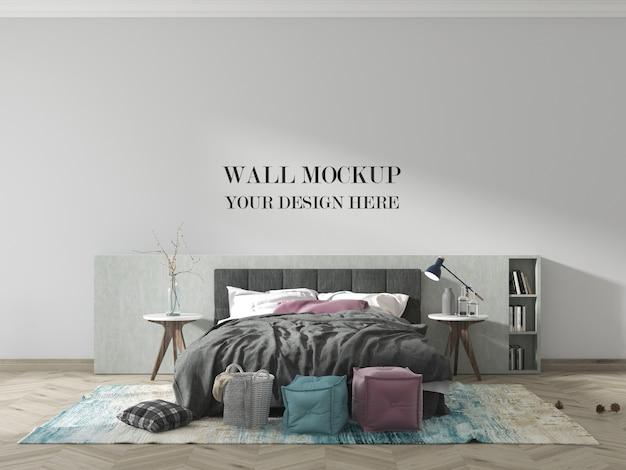Maquette de mur de chambre moderne avec lit et couverture