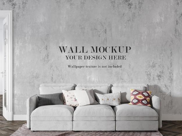 Maquette de mur derrière un canapé blanc
