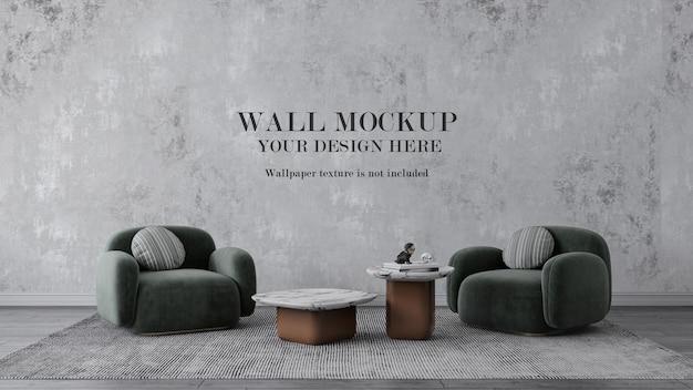 Maquette de mur derrière des fauteuils verts modernes