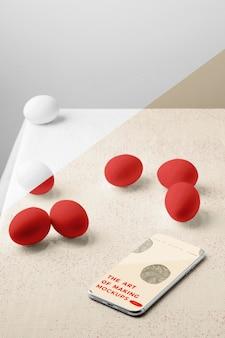 Maquette d'œufs à angle élevé avec smartphone