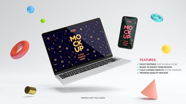 Maquette d'ordinateur portable et de téléphone flottant entouré d'objets géométriques