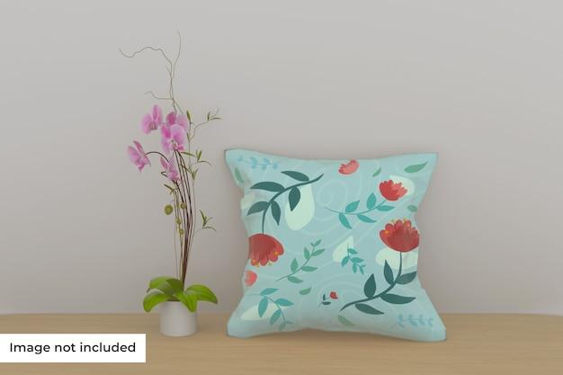 Maquette d'oreiller sur étagère avec fleur
