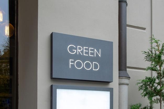 Maquette de outdoor street urban logo signe sur le mur