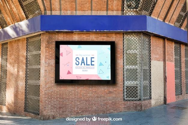 Maquette de panneau d'affichage sur le mur de briques