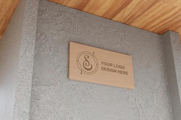 Maquette de panneau de logo dans le mur de béton