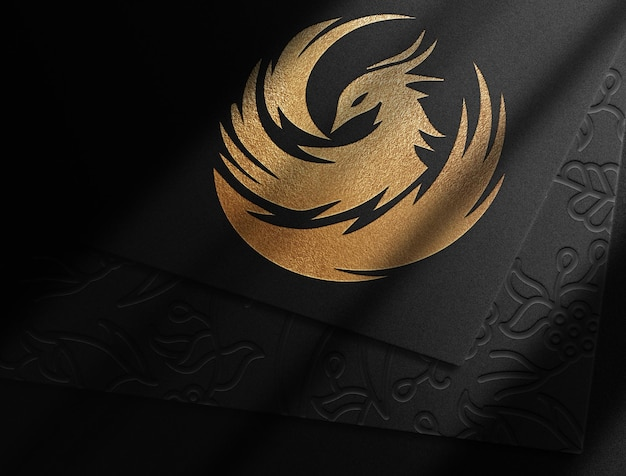 Maquette de papier logo en relief or phoenix gros plan de luxe
