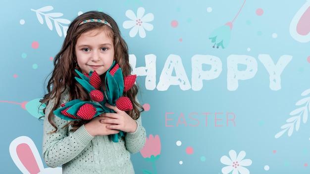 Maquette de pâques avec une fille brune tenant des fleurs