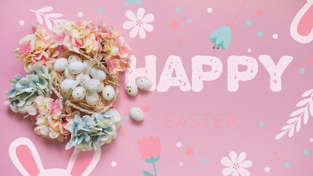 Maquette de pâques avec des oeufs et des fleurs