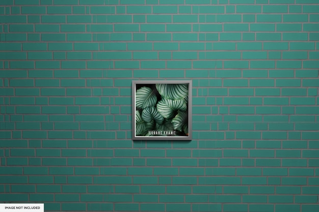 Maquette photo à cadre carré avec affiche de cadre wallf vert avec mur vert