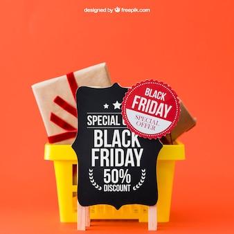 Maquette pour vendredi noir avec des cadeaux dans le panier