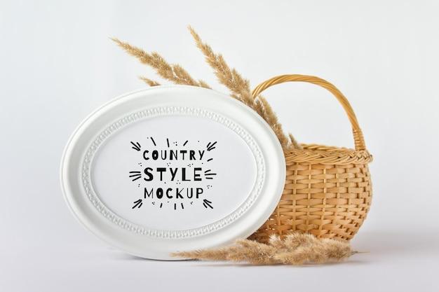 Maquette psd modifiable avec composition créative de style country de panier en bois et cadre ovale rond